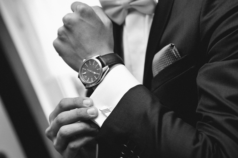 James-wearing-watch-and-suit