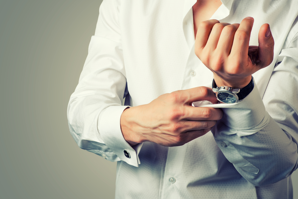 Man wearing white shirt and Bovet watch on wrist