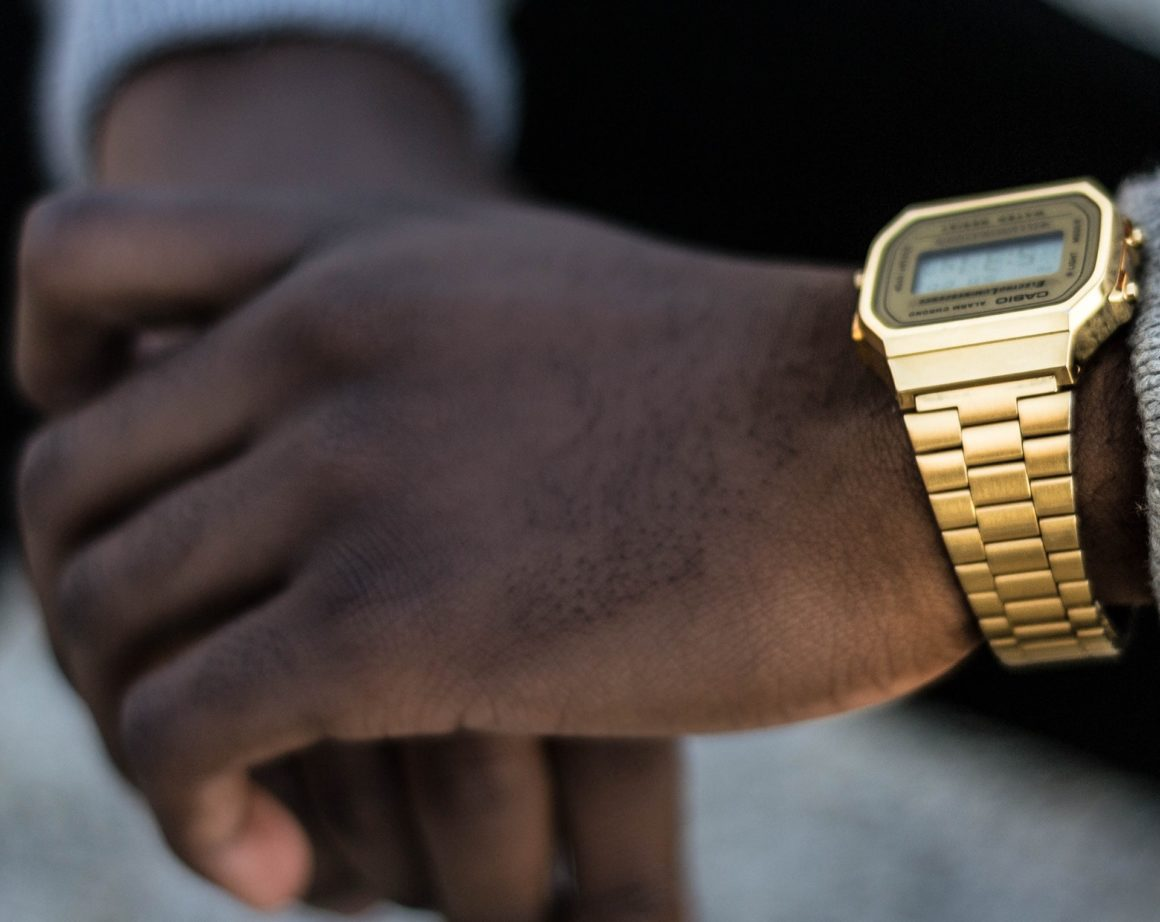 man-wearing-gold-casio-digital-watch