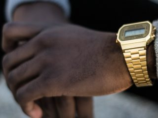 man-wearing-gold-casio-digital-watch