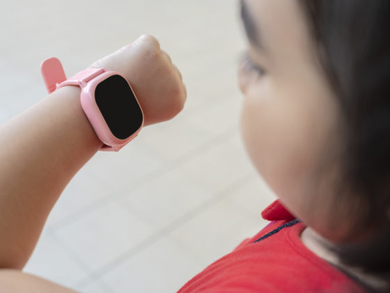 Young girl looking at a GPS watch