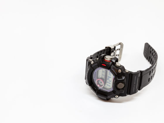 A black Casio GW-9400 watch on a White Background