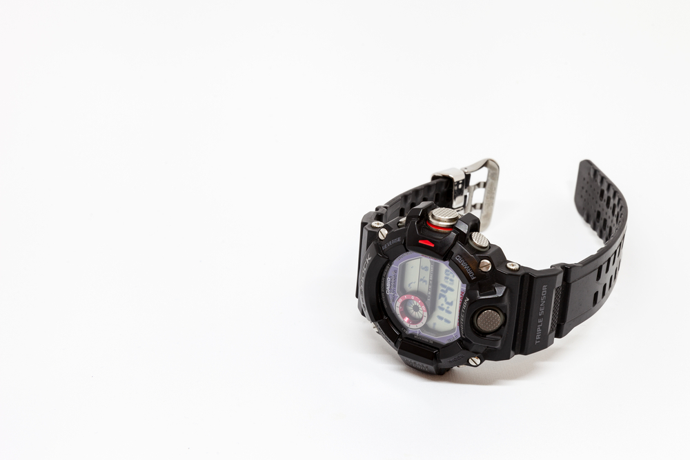 A black Casio GW-9400 watch on a White Background