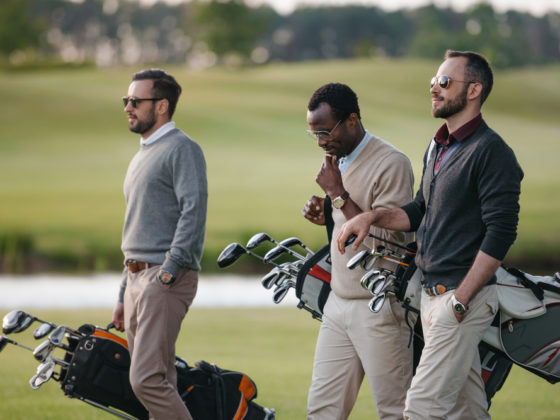 Men-playing-golf-with-watches-on