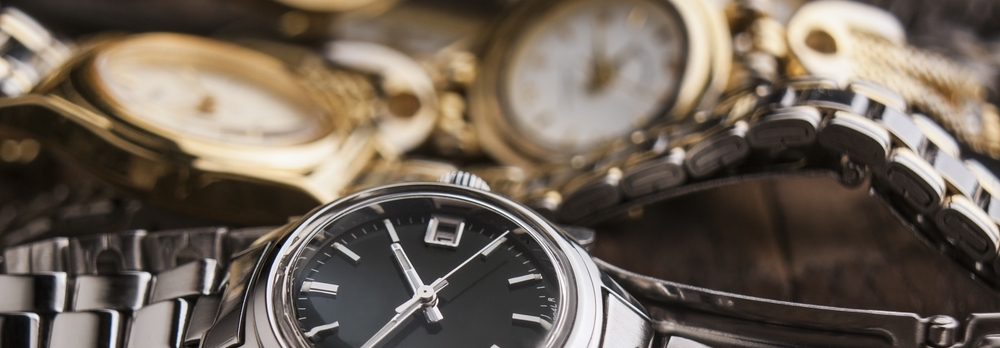 Collection of women's watches on table