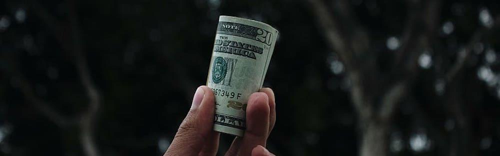 hand-holding-dollars