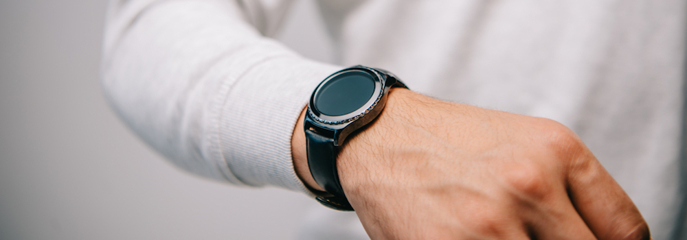 man-wearing-smart-travel-watch