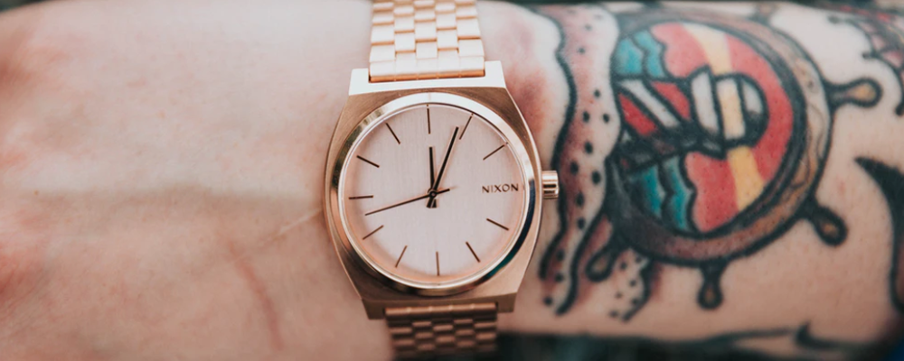 Bronze watch on person's wrist