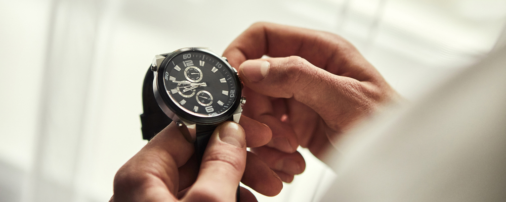 businessman checking time on his wrist watch, man putting clock on hand,groom getting ready in the morning before wedding ceremony. Men Fashion
