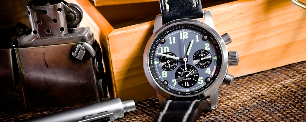 still life with wristwatch, compass and lighter
