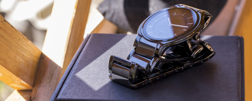 Luxury mens watch made of black high-tech ceramics with original packaging. Close-up photo.