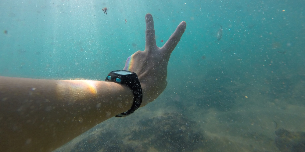 Man underwater with wrist watch