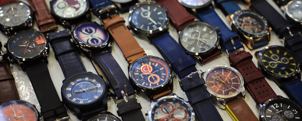 Men's wrist watches on the market counter