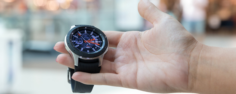 Samsung Galaxy Watch 46 displayed in hand on isolated background
