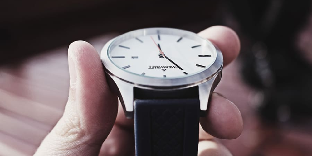 Person holding wrist watch