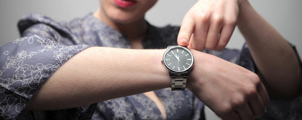 Woman tapping her wrist watch