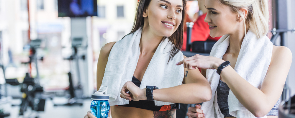 Woman with watch on a gym