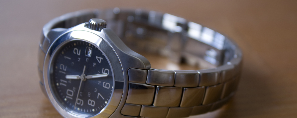 Ladies stainless steel watch on a wood table
