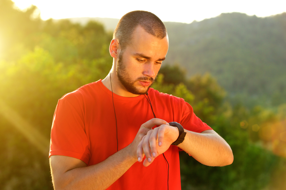 Man-looking-at-exercise-watch