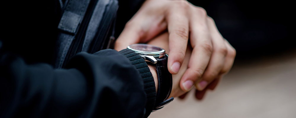 Person's hand with wristwatch