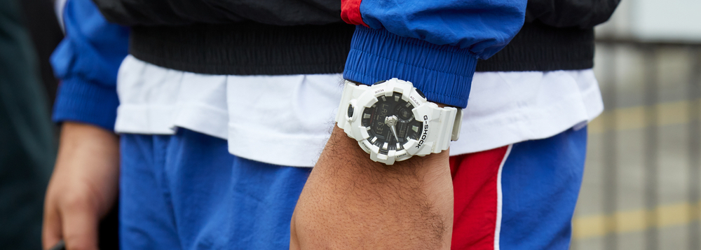 A man wearing a retro tracksuit and white Casio G-Shock.