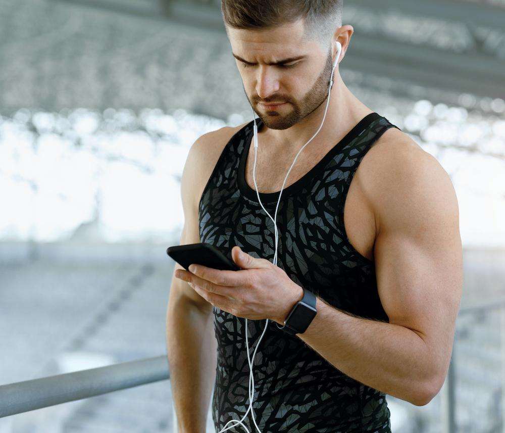 Stylish man wearing a sports watch