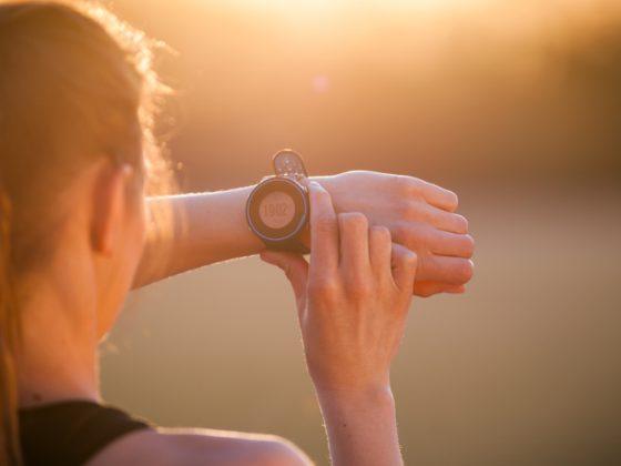 Woman setting up smart watch