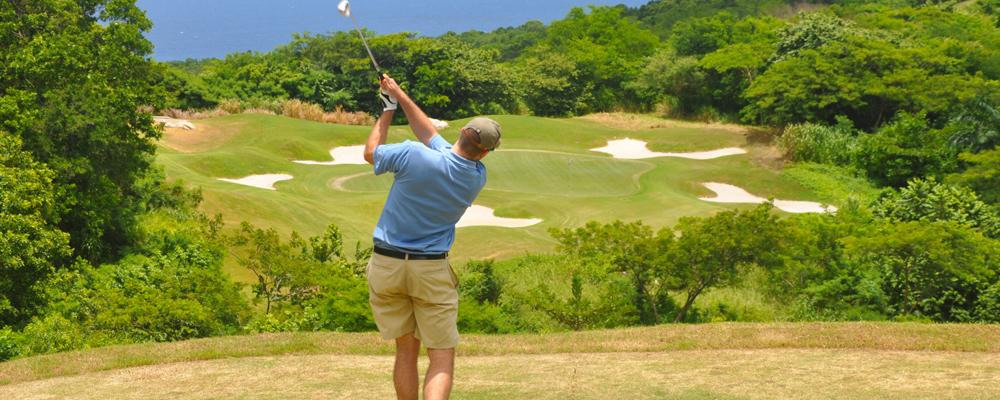 Golfer on par 3 at course