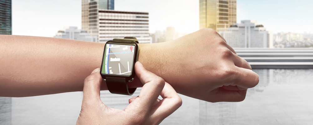 Hand setting route for GPS on the smart watch. Technology concept