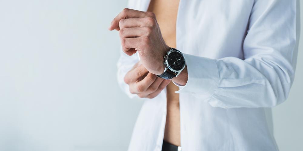 Man in white shirt wearing wristwatch