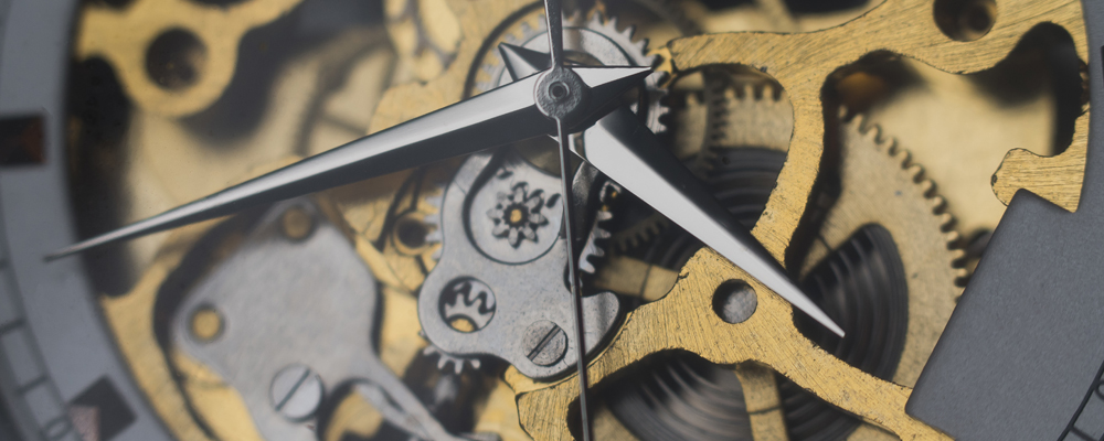 Mechanical skeleton watch with visible gears