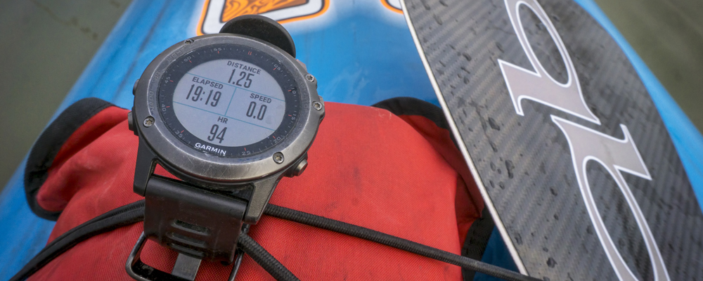 Multisport Garmin GPS watch on paddleboard