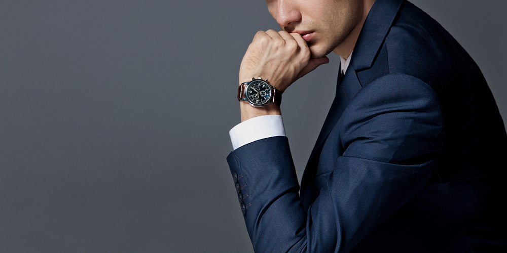 Man in an expensive suit and watch
