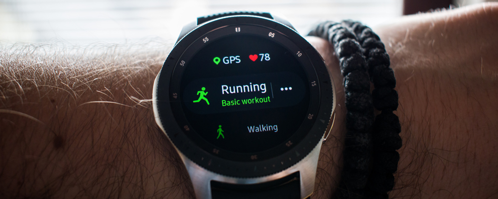 Smart watch on mans hand, running basic workout