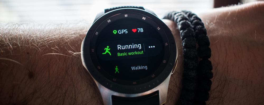 Smart watch on mans hand, running basic workout