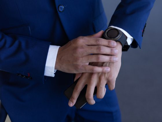 Businessman using smartwatch