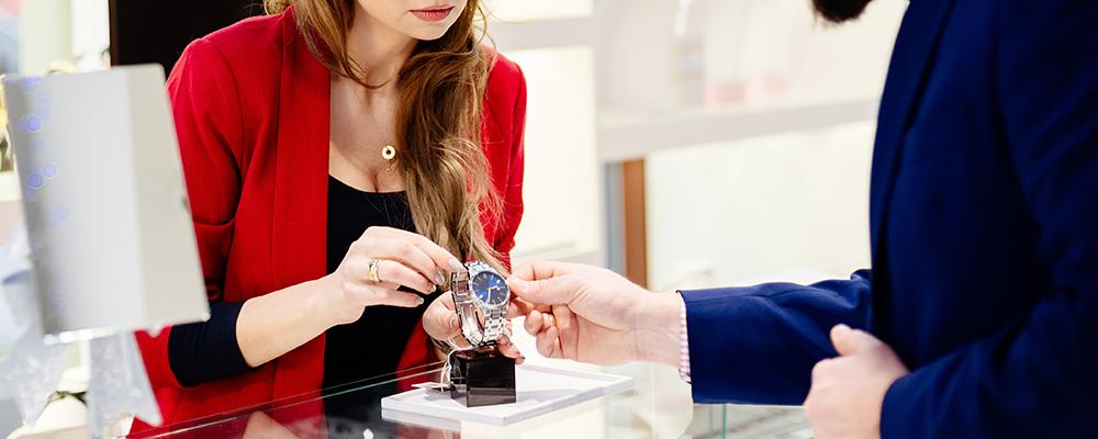 Man buying wrist watch