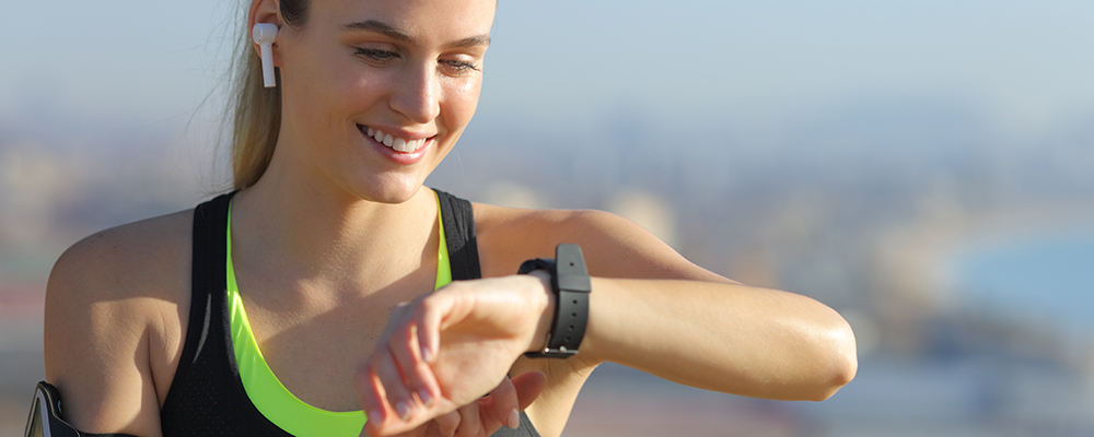 Runner checking smartwatch