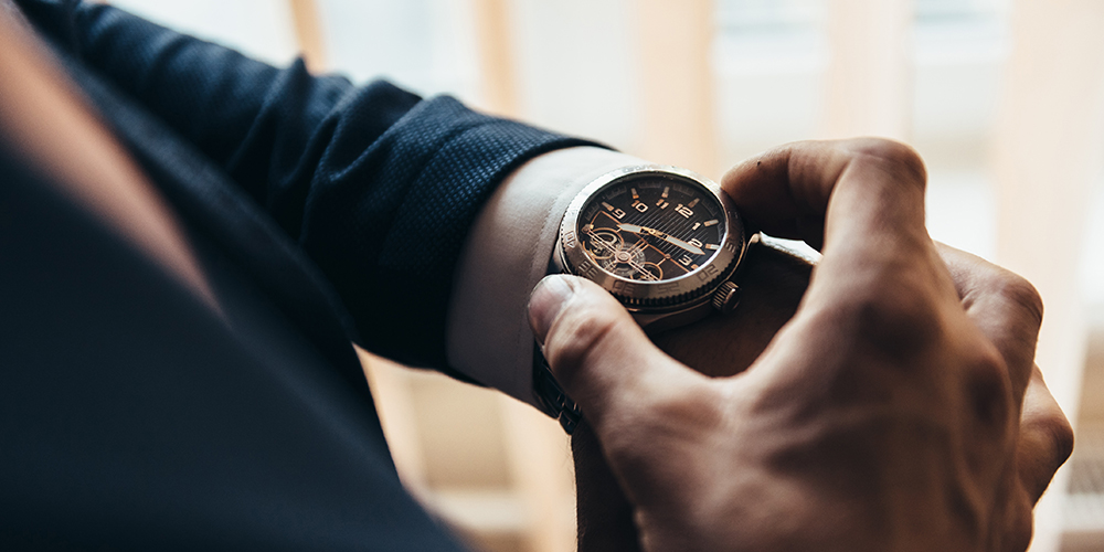 Man with mechanical watch